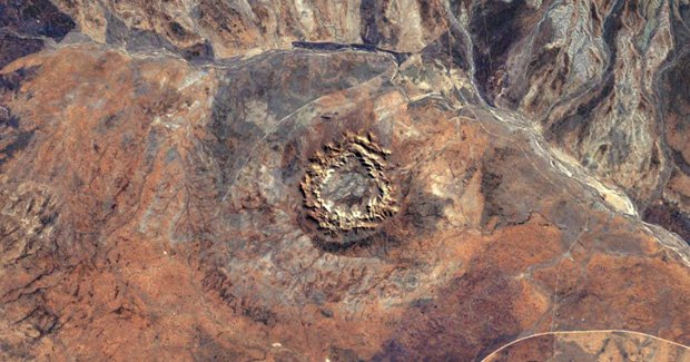The impact crater was caused by an asteroid slamming into Earth between 298 and 360 million years ago, which places it in the same epoch as the Late Devonian mass extinction [Credit: NASA Earth Observatory]